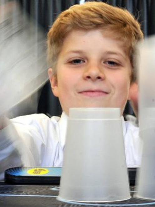 William McLauchlan (12) shows that cups are not just good for drinking from. Photo by Craig Baxter.
