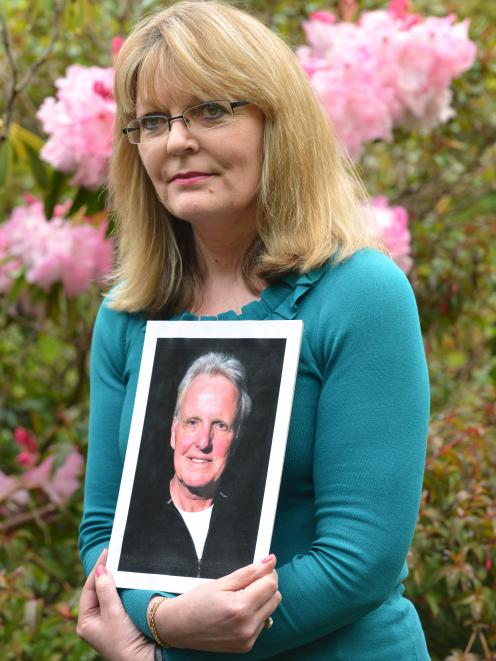 Debbie Williamson, of Dunedin, holds a picture of her late husband, Brendon Garden, who died from...