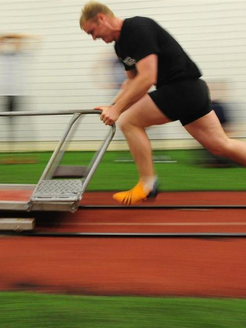 Willie Trew trains with the New Zealand bobsleigh team at the New Zealand Academy of Sport in...