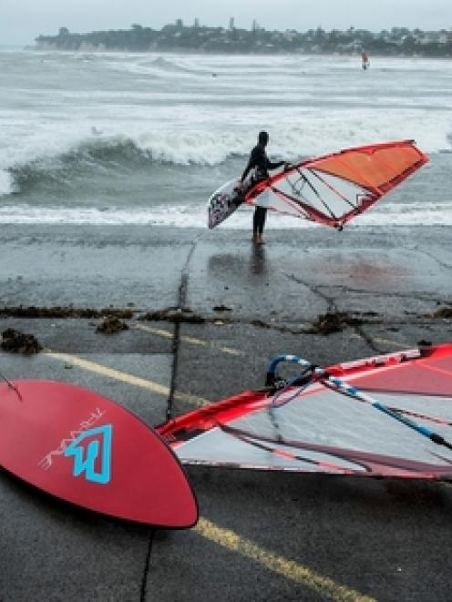 Windsurfers headed to Takapuna Beach on Auckland's North Shore yesterday to take advantage of...