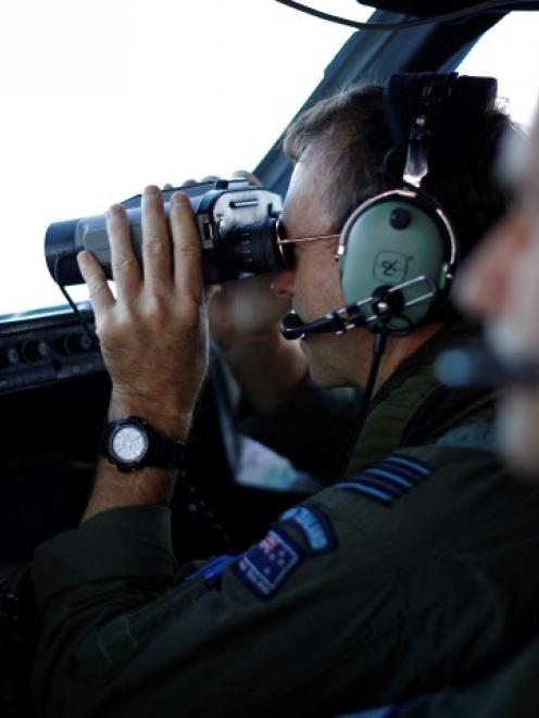 Wing Commander Rob Shearer looks out from the flight deck of a Royal New Zealand Air Force P-3K2...