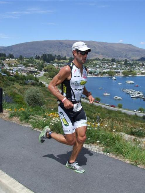 Winner Richard Ussher heads back to the transition point on the Lake Wanaka foreshore near the...