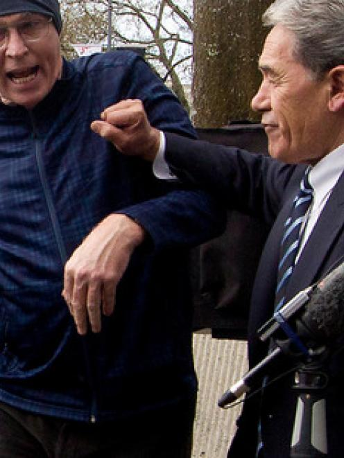 Winston Peters pushes off a heckler outside the Hamilton City Council Building in Garden Place at...