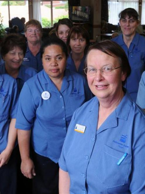 Wishing unit nurse manager Ruth Porteous (foreground) a happy retirement are fellow members of...