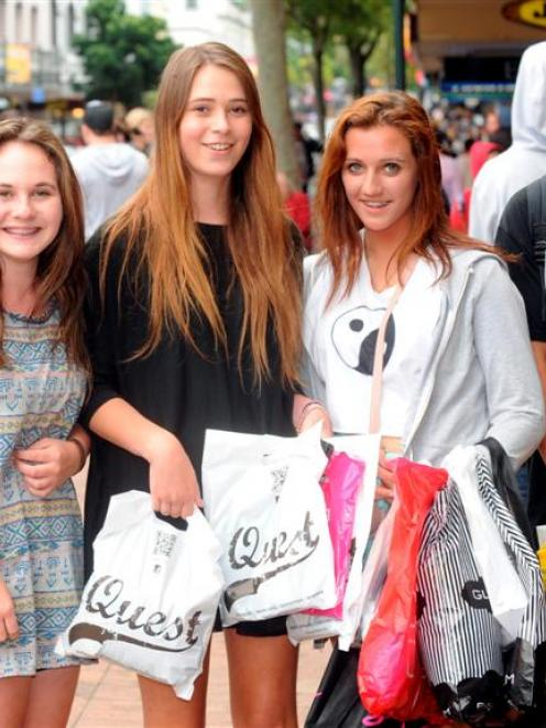 With bags full of clothes bought from Boxing Day sales, Dunedin teenagers (from left) Emma...