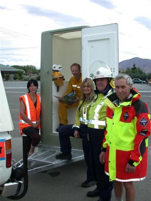 With the new toilet are (from left) Jan Perriam (Civil Defence), Craig Dawson (Waitaki Rural Fire...