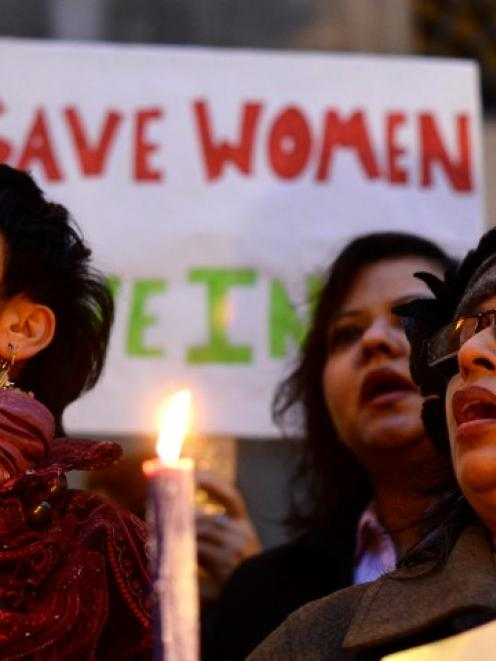 Women protest outside the Indian High Commission in London. Five men accused of raping and...