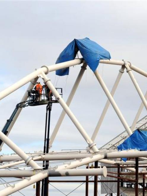 Work is carried out on the Forsyth Barr Stadium roof truss,. Photo by Stephen Jaquiery.