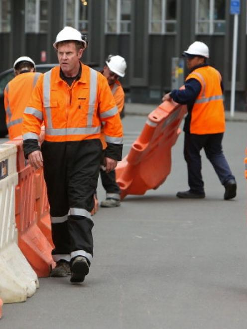 Workers at a cordon on Maginnity Street after surrounding buildings sustained earthquake damage. ...