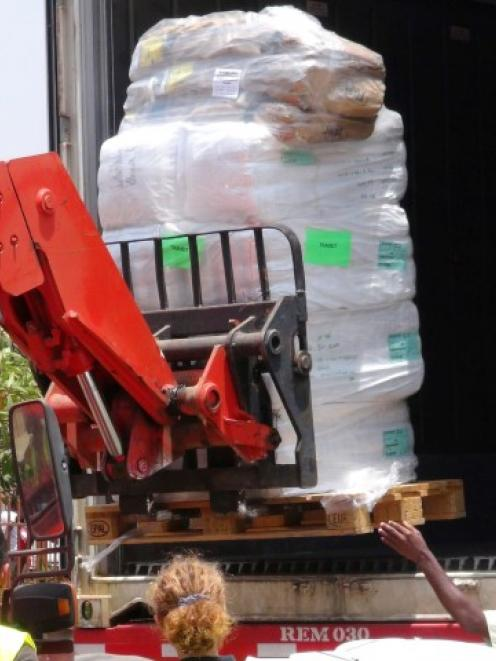 Workers from Doctors Without Borders unload emergency medical supplies to deal with an Ebola...