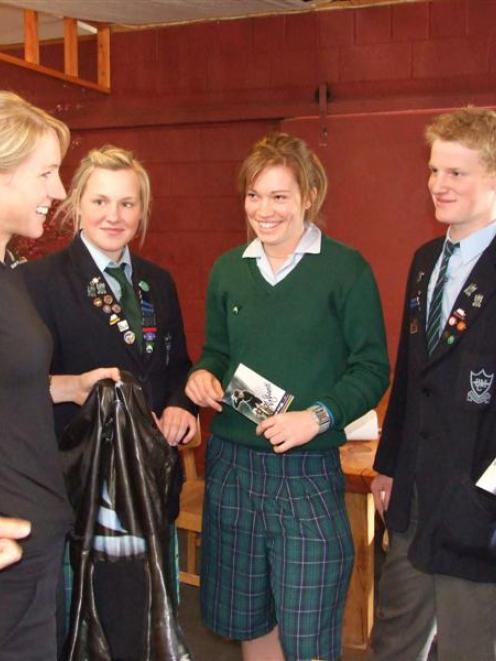 World champion cyclist Alison Shanks (left) shows Blue Mountain College (Tapanui) pupils Avana...