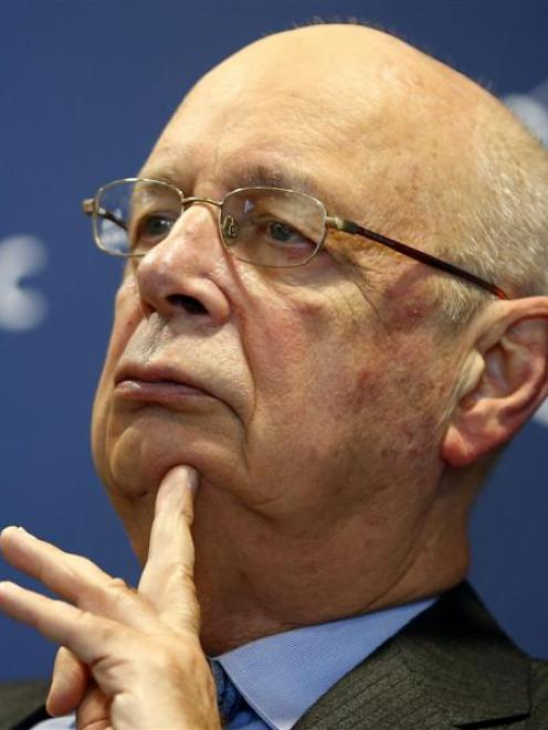 World Economic Forum executive chairman and founder Klaus Schwab pauses during a news conference...