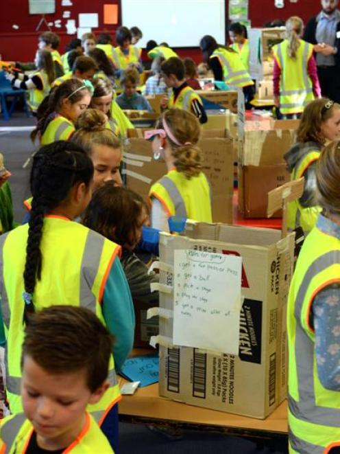 Year 4, 5 and 6 pupils at Opoho School take part in the  cardboard arcade challenge on Friday. ...