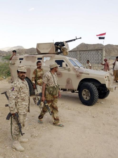 Yemeni soldiers gather at a military post in al-Mahfad in the southern Yemeni province. Photo by...