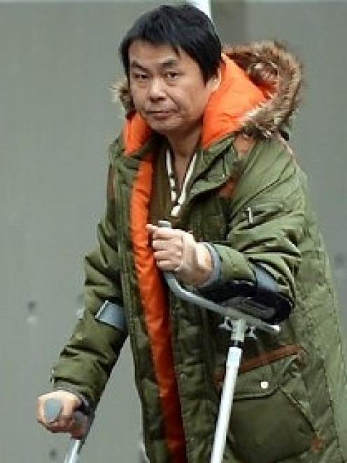 Yong Wang (43) walks to the Dunedin District Court yesterday.  Photo by Peter McIntosh.