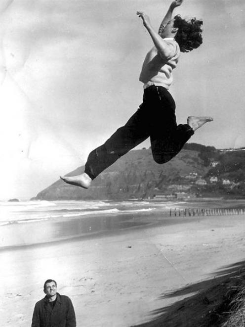 Yvette Williams practises her long jump technique off the sand at St Clair, in Dunedin, (approx...