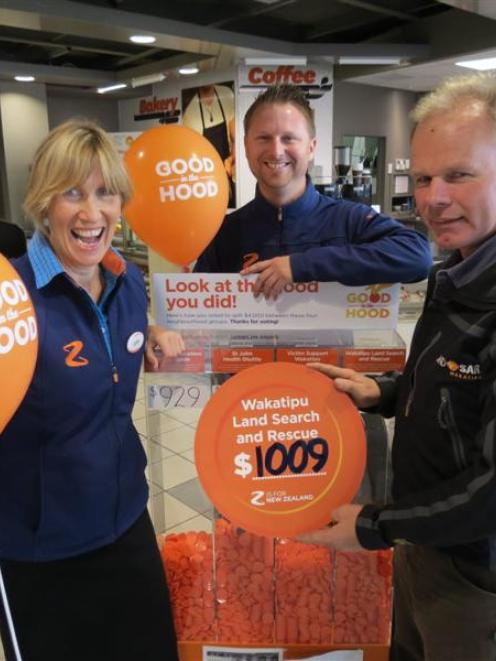 Z Queenstown retailer Lynne Burns, site leader Joel Popplewell and Wakatipu LandSAR committee...