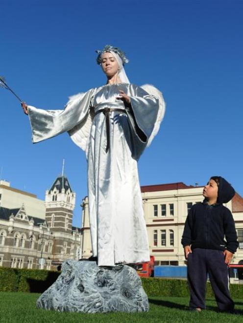 Zacharie Santana (3), of Dunedin, admires angel Natapiya Dryshchuk, of Christchurch, at the ...