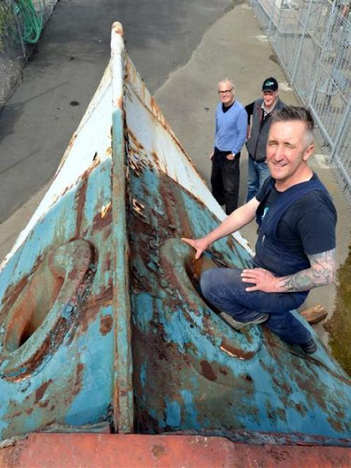 Zeal Steel owner Lawrie Forbes and sculptors Peter Nicholls and Stephen Mulqueen examine the bow...
