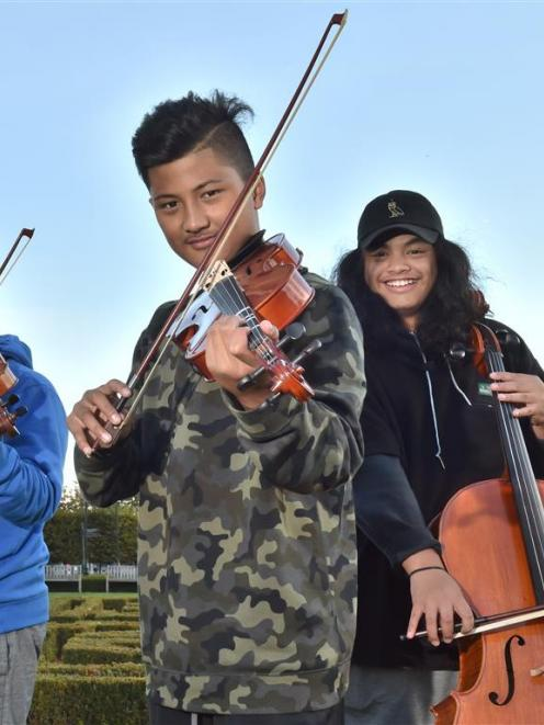 Virtuoso Strings members (from left) EJ Roebeck (12, violin), Avia Lemisio (12, viola) and Atonio...