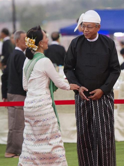 Burma's new President Htin Kyaw welcomes National League for Democracy party leader Aung San Suu...