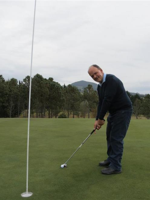 Island Park Golf Club committee member Peter Bezett tests out a green in preparation for the club...