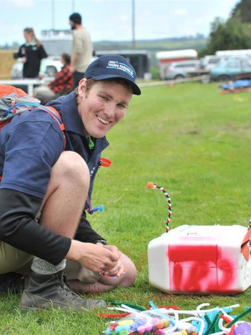 "Logan Wallace takes part in the ""make a letterbox"" section of a Young Farmer of the Year event in..."