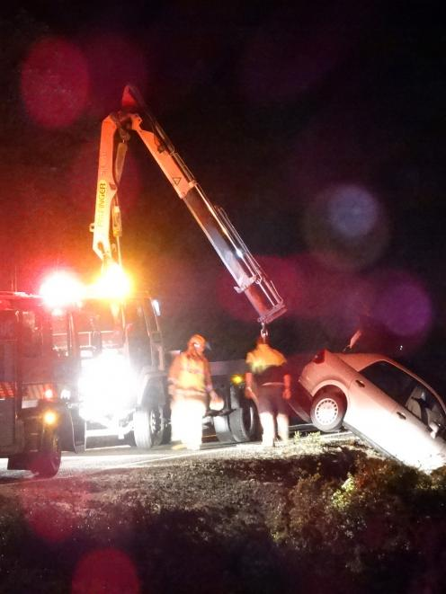 A rental car is pulled from a steep bank on the Devil's Staircase along State Highway 6, south of...