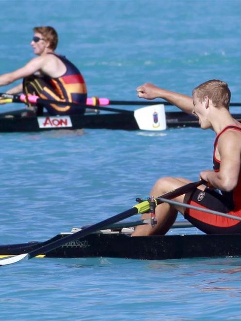 Waitaki Boys' High School single sculler Mark Taylor  celebrates his win in the boys under-17...
