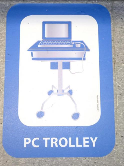 A floor mat for computer trolley.