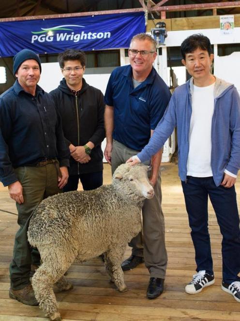 Inspecting  an animal at Closeburn Station are station owner Tony Clarke (left), Nagao Shoji vice...