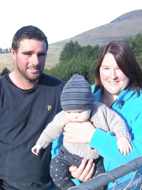 David and Sarah Smith, with their youngest son, Wade, at home on Mt Watkins in East Otago. Photo...