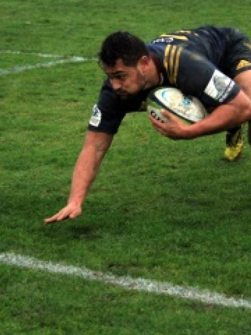 Highlanders winger Fa'asiu Fuatai scores a try against the Crusaders at Whitestone Contracting...