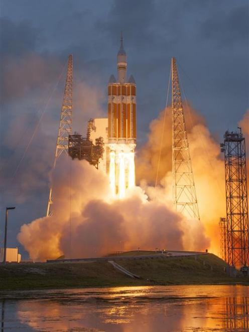 The Lockheed Martin-built Orion spacecraft launches from Cape Canaveral, Florida, aboard a United...