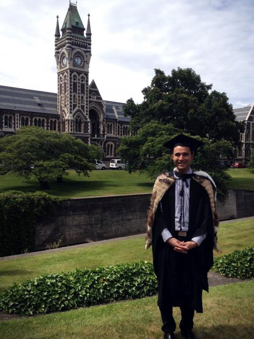Nick Callaghan after graduating with a bachelor of social work degree from the University of...