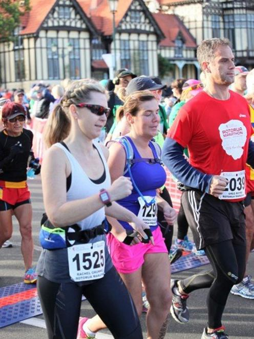 Hannah Pascoe (centre) is helped by guides Rachel Grunwell and Greg Boyd at last year's Rotorua marathon. Photo supplied.