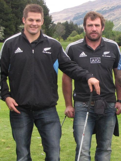 Former All Blacks captain Richie McCaw (left) and Andrew Hore relax during a game of golf in...