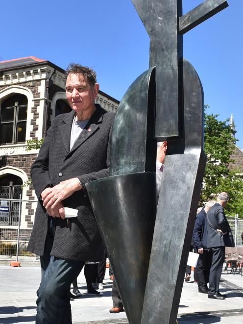 Palmerston North artist Dr Paul Dibble with one of the five bronze sculptures in his artwork...