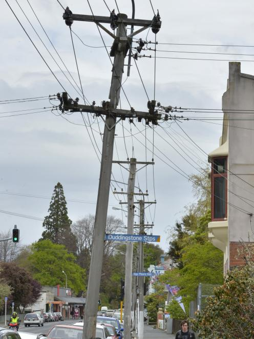 Power poles tied together in Moana Rua Rd. PHOTO: STEPHEN JAQUIERY