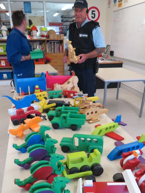 Otago Corrections Facility carpentry instructor Mark O'Kane with toys prisoners made for children who were in Dunedin Hospital. Photo supplied.