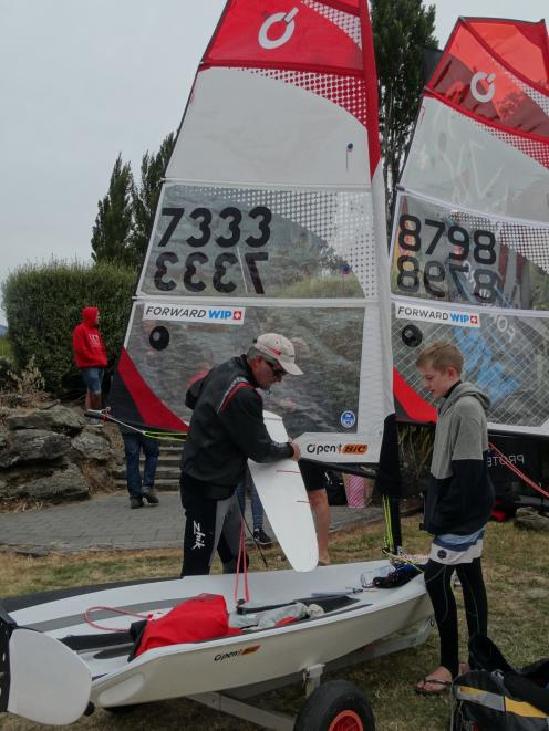 Sir Russell  helps Jacob Goodall,  of Napier, prepare for the inaugural O'Pen Bic race on Lake...