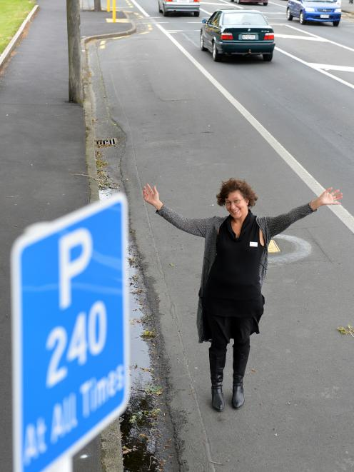 Gillions Funeral Services business manager Elizabeth Goodyear yesterday celebrates the new parking restrictions in Hillside Rd. Photo by Stephen Jaquiery.