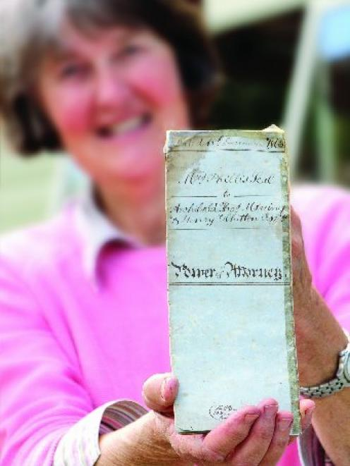 Edith Cromie, of Waihao Downs, displays the 153-year-old declaration of title to the brig Grecian...