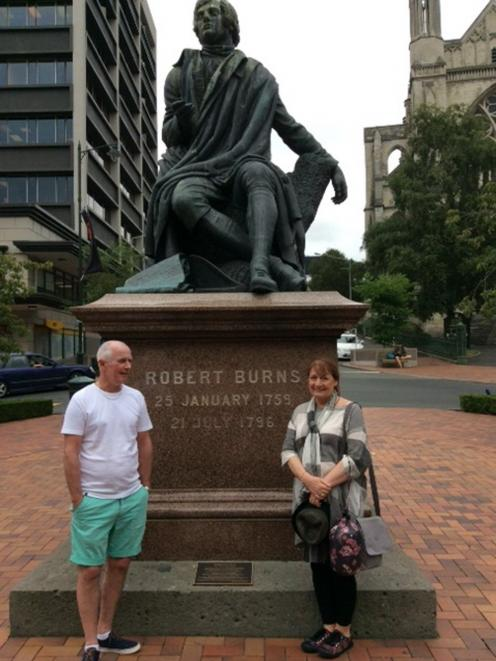 Frances Ainslie visits Dunedin's statue of Robbie Burns in the Octagon last year with friend Robert Beaton.