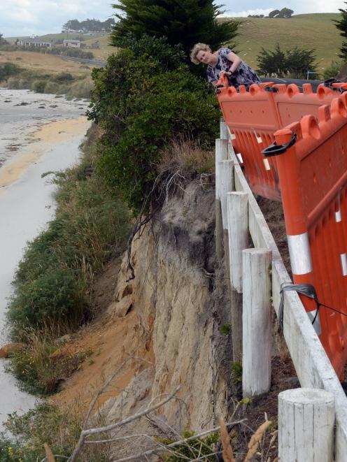 Saddle Hill Community Board deputy chairwoman Leanne Stenhouse examines erosion threatening part...