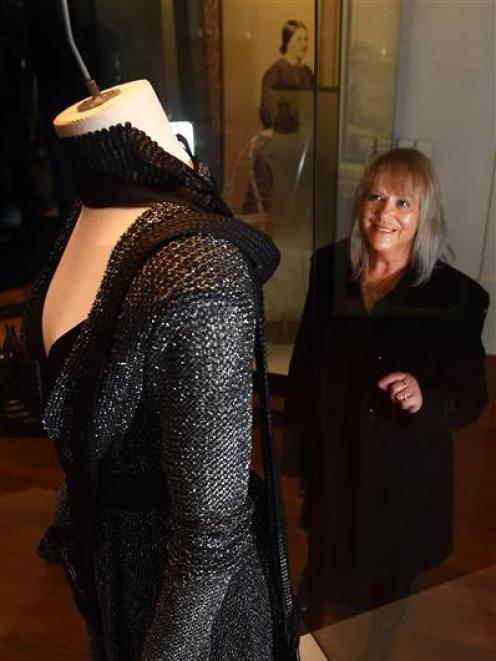 Dunedin fashion designer Donna Tulloch, of Mild-Red, with a garment from her Black Knight...