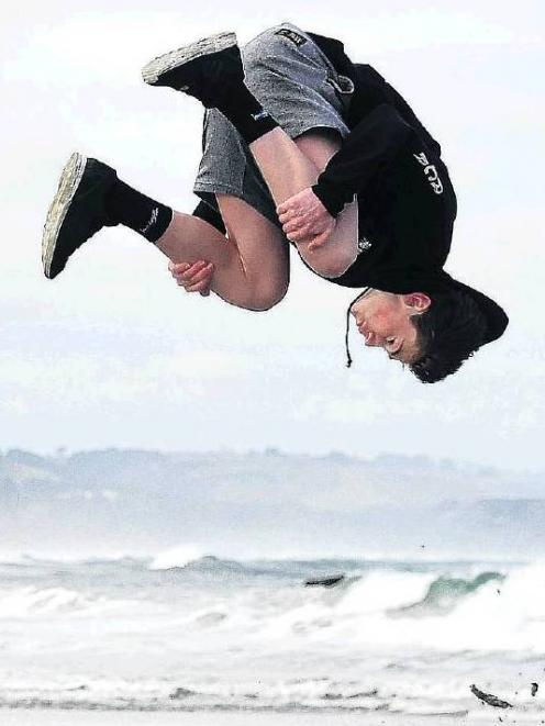 Cody Veenvliet practises parkour on Brighton beach before heading to the first New Zealand...