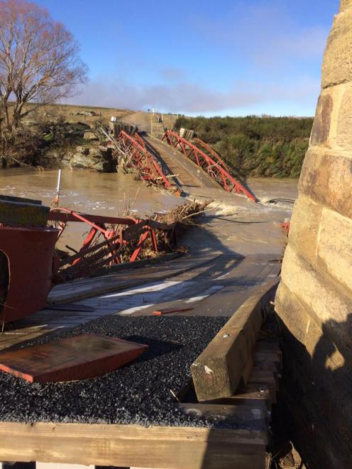 The Sutton suspension bridge d after the flood.