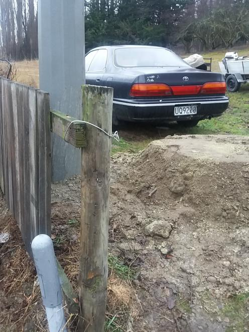 A 45cm-high pile of dirt is left behind after a power pole was replaced on Clive Cullen's Letts...