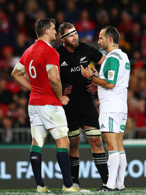 Sam Warburton of the Lions and Kieran Read of the All Blacks talk to referee Romain Poite during...